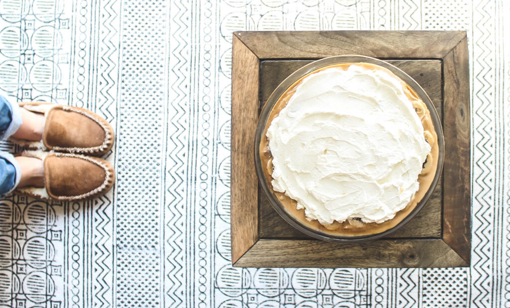Finished pie topped with whip.