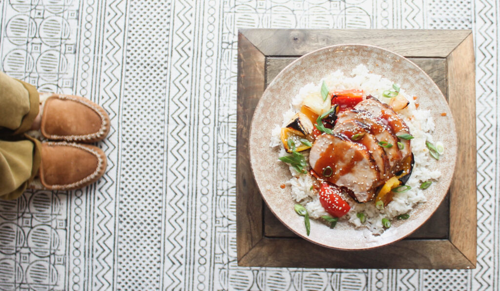 Serve the sweet and sour pork loin roast over cooked white rice along with the roasted peppers and onions.