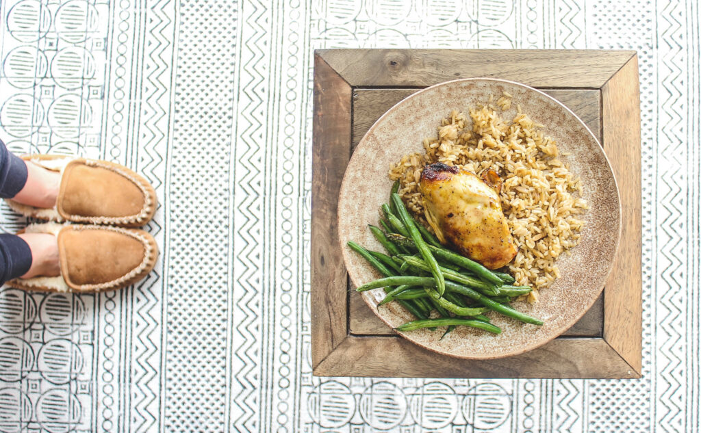 Finished plate of honey dijon chicken, rice pilaf and green beans.