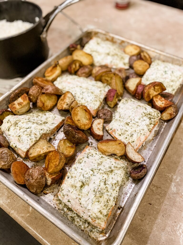 sheet pan of herby baked salmon and potatoes.