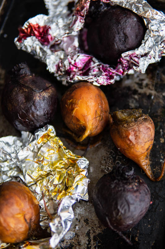 Foil wrapped Simply Oven Roasted Beets on a baking sheet.