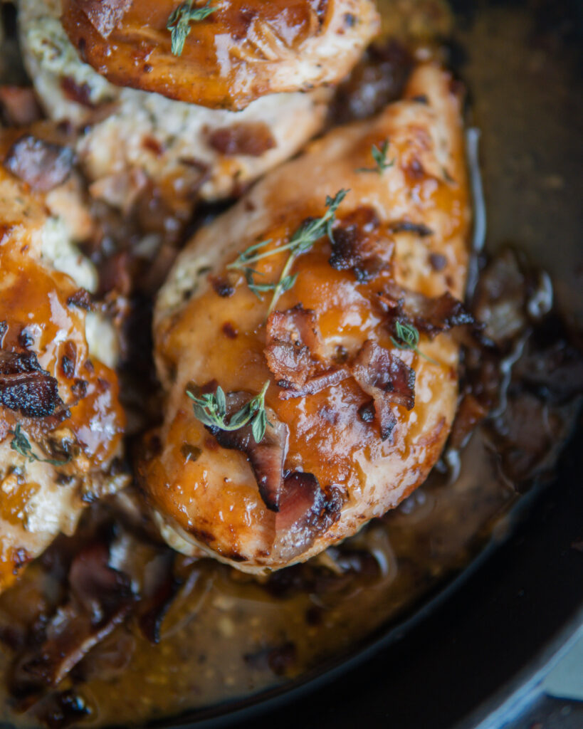 One Apricot Chicken covered with bacon bits and fresh thyme.