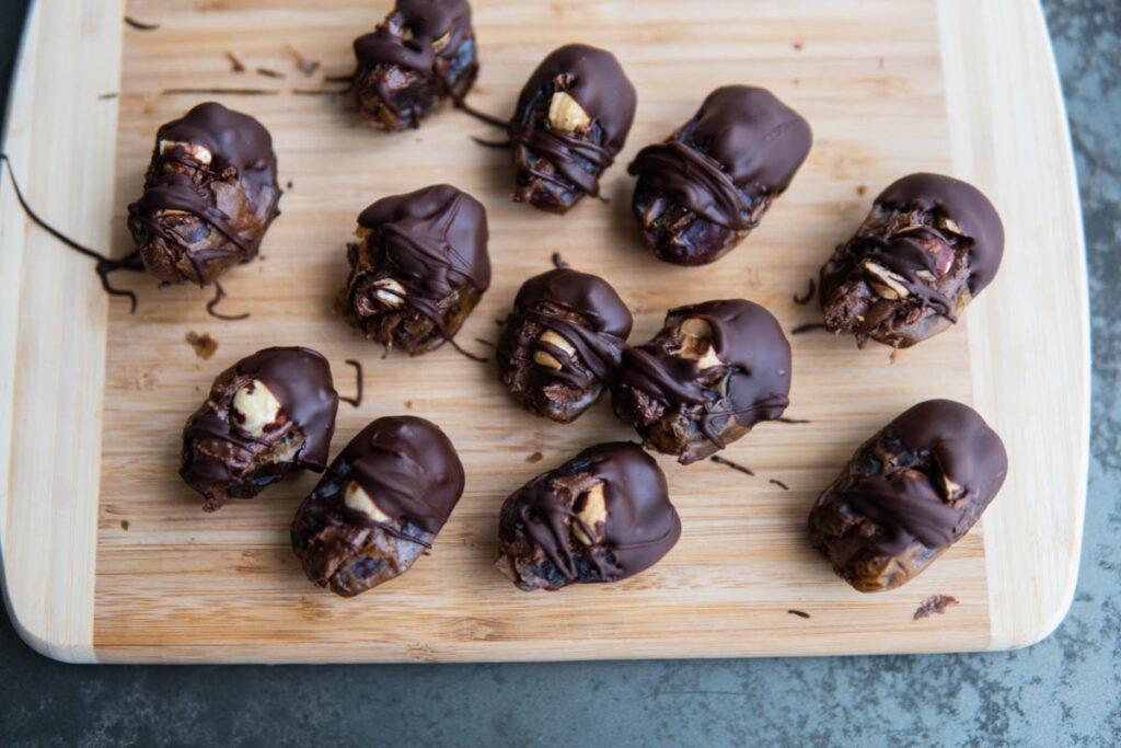 full cutting board of Chocolate Hazelnut Stuffed Dates.