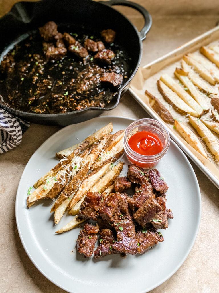 Plate of Garlic Steak Parm Frites.