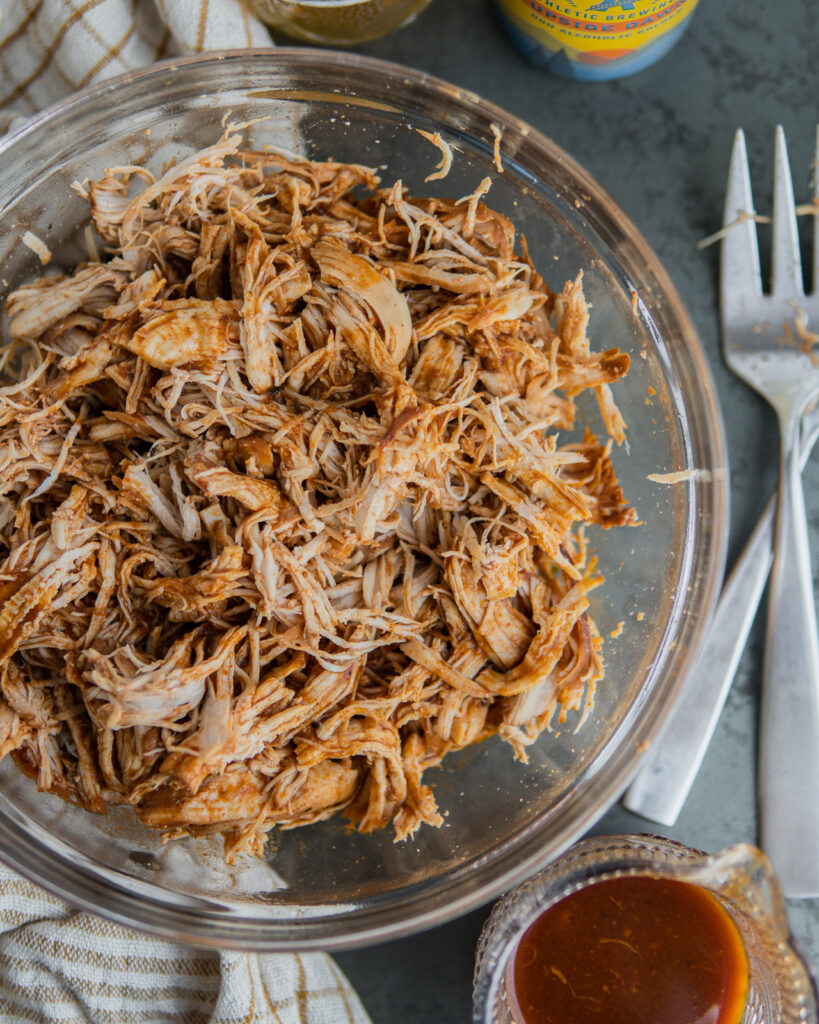 Beer & BBQ Pulled Chicken shredded in a bowl.