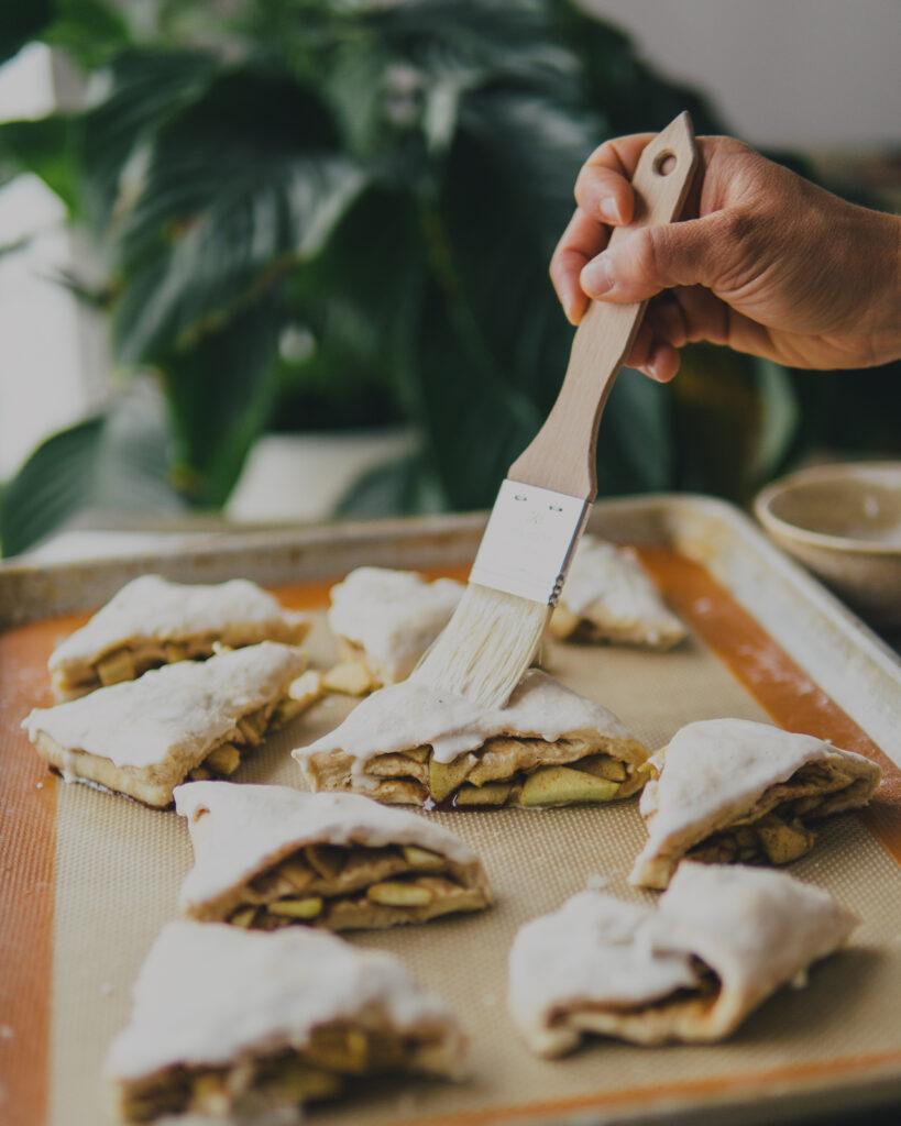 Brushing scones with heavy cream.