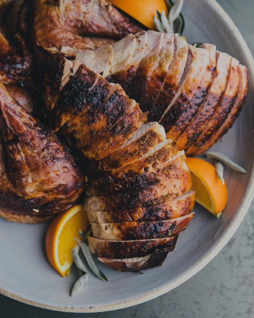 Sliced turkey breast on a serving platter.