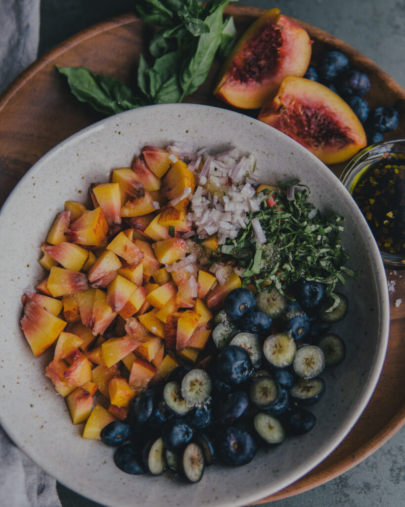 Ingredients for summer fruit salsa measured into one bowl.