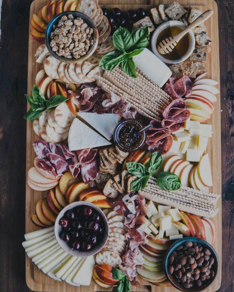 Full Summer Charcuterie Board Spread on a large cutting board.