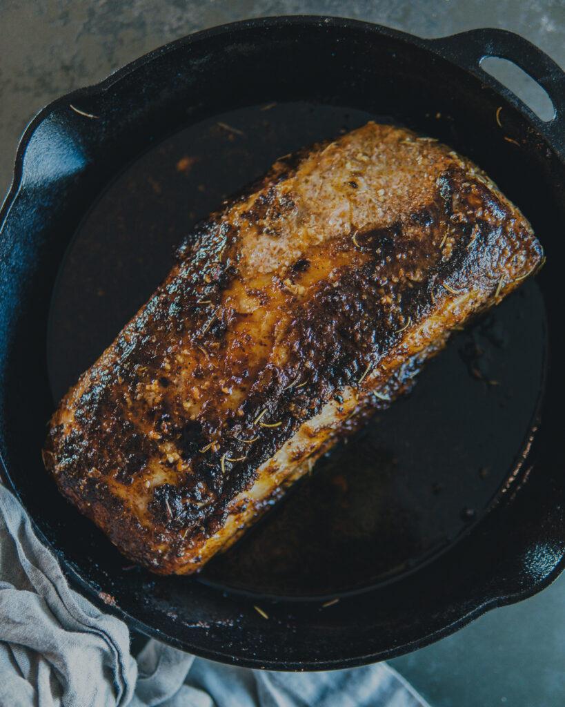 Pork loin roast in a cast iron pan.