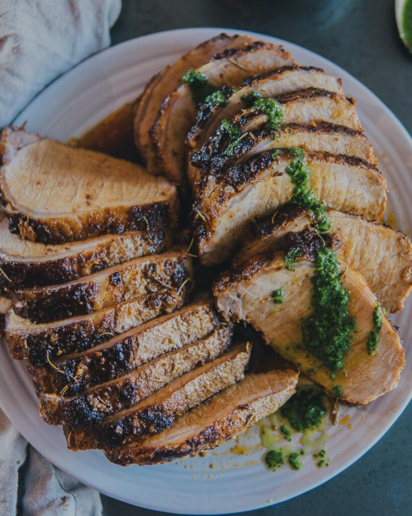 Full plate of Santa Maria Pork Loin Roast with Chimichurri.