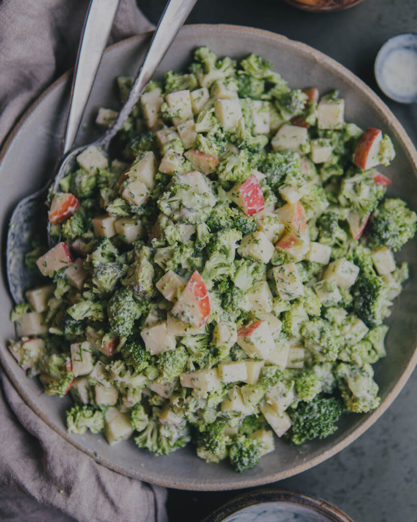 Complete Broccoli, Apple, Cheddar and Dill Ranch Salad in a large serving bowl.