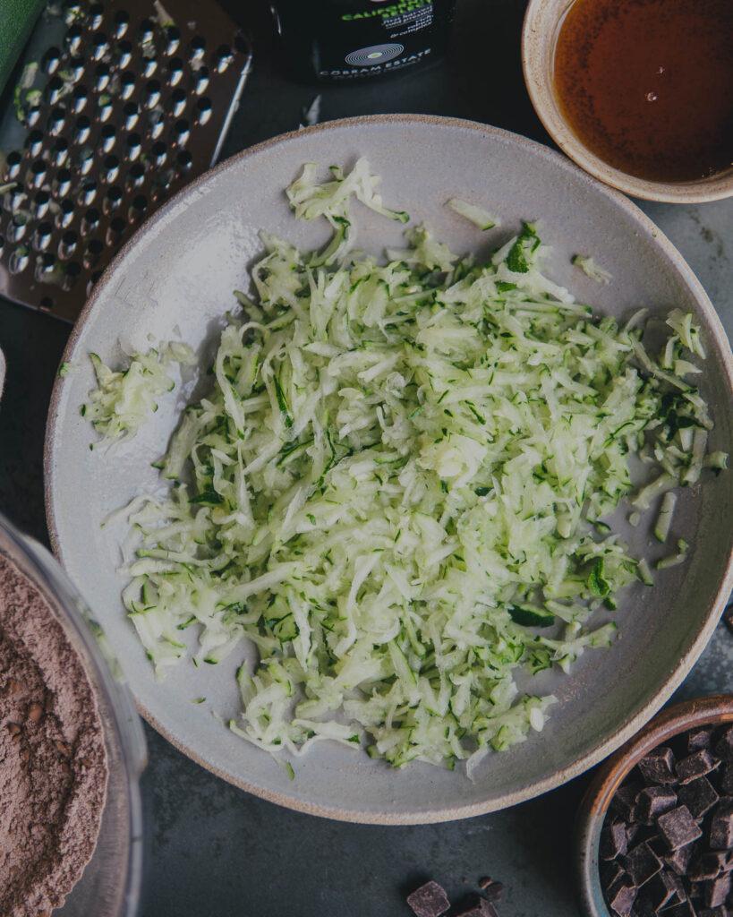 Shredded zuchinni in a bowl.