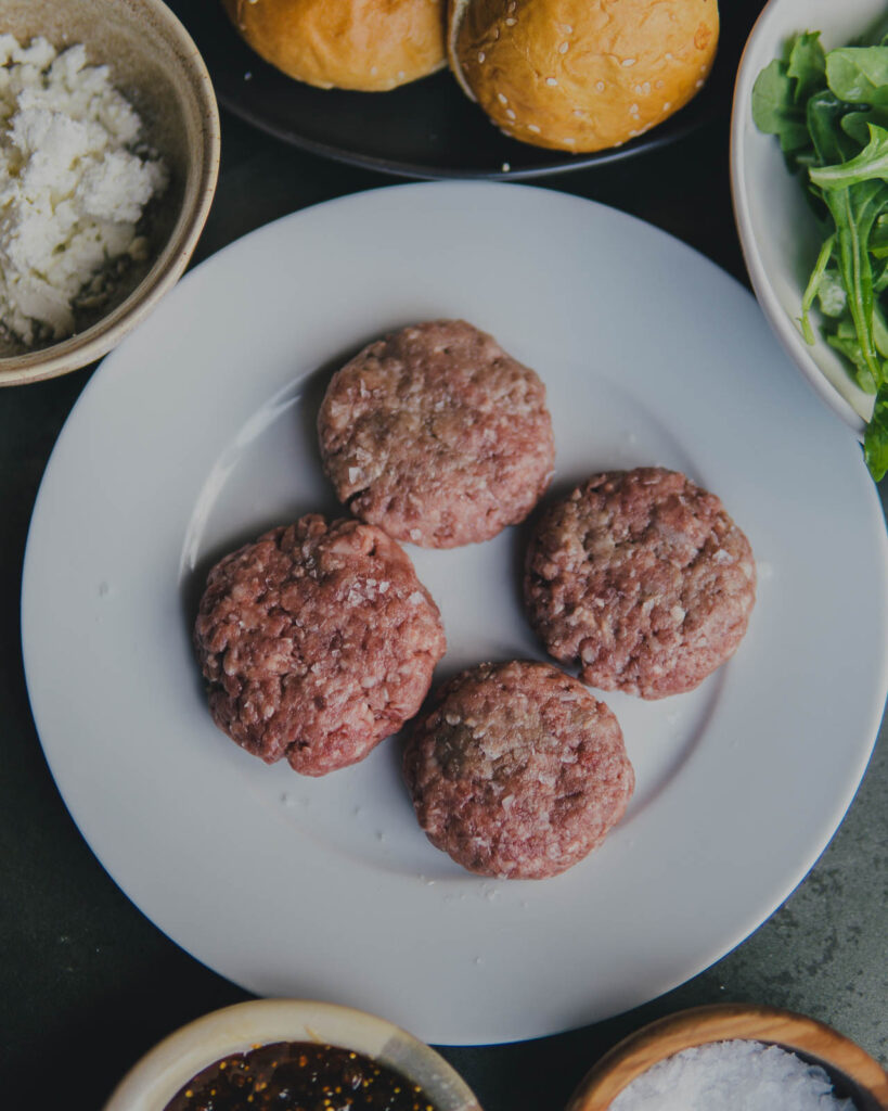 Ingredients and plate of raw sliders.