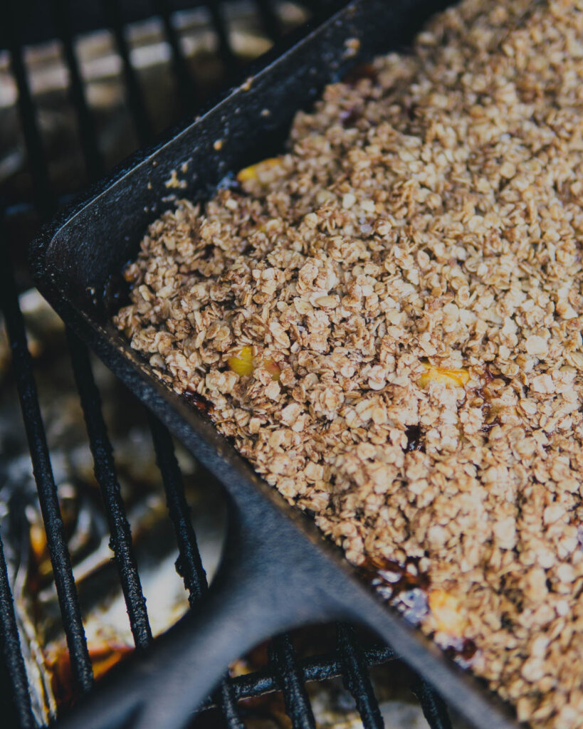 Traeger Nectarine Crisp in a cast iron skillet on the Traeger grill.