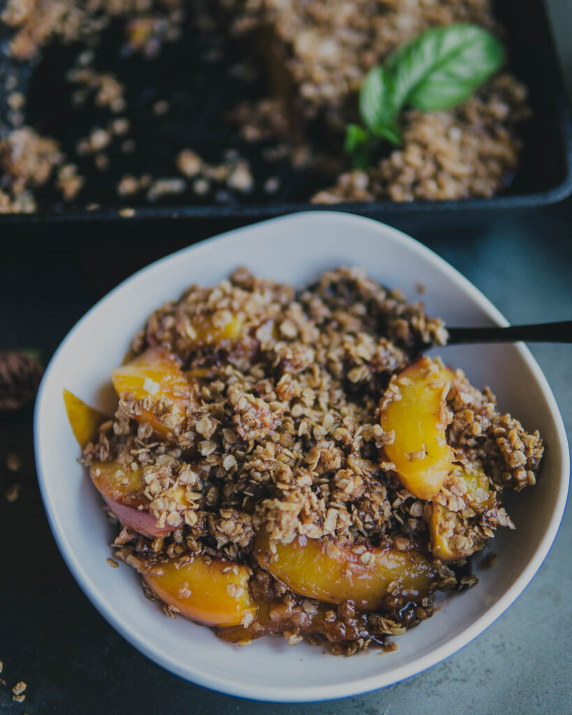 Traeger Nectarine crisp in a bowl ready to serve.