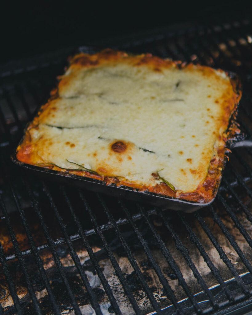 Cast iron zucchini lasagna in the Traeger grill