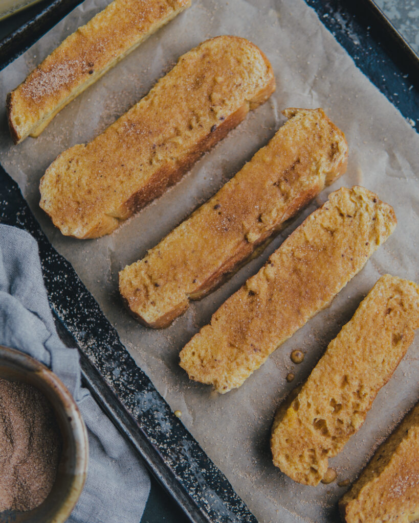 Uncooked french toast sticks dipped in the cinnamon and sugar mixture.