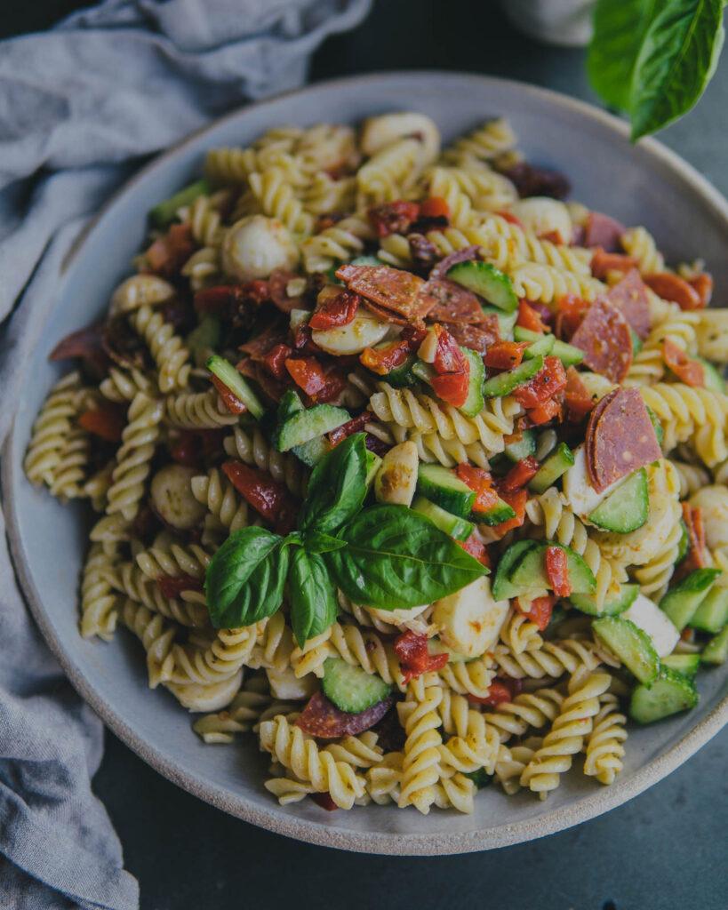 Pepperoni & Pesto Pasta Salad in a large serving bowl.