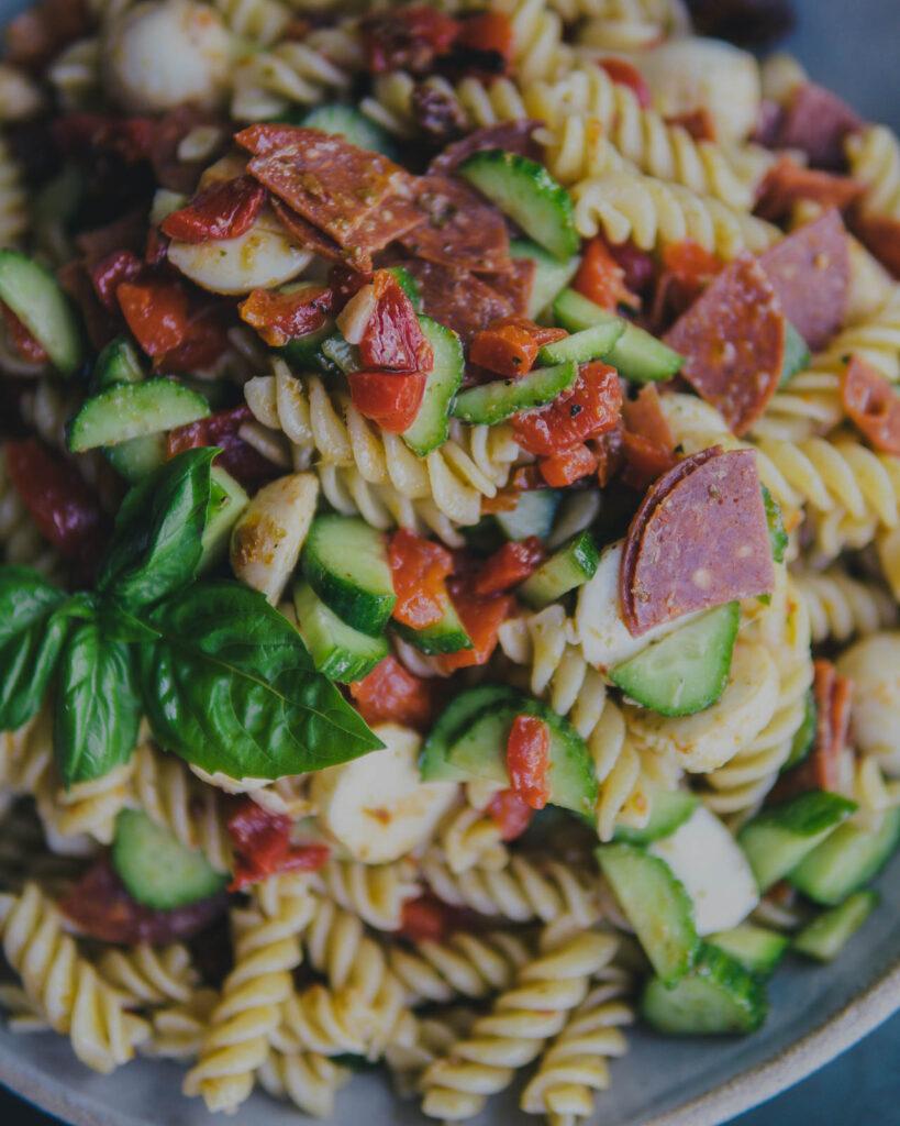 closeup of finished pepperoni & pesto pasta salad