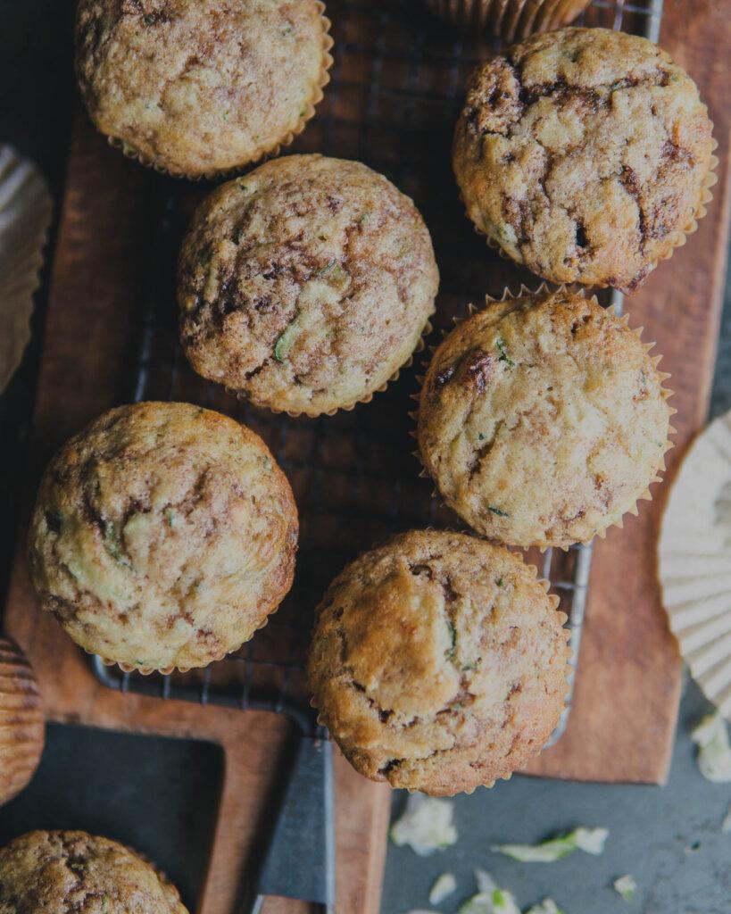 Cinnamon sugar zucchini muffins on a cooling rack.