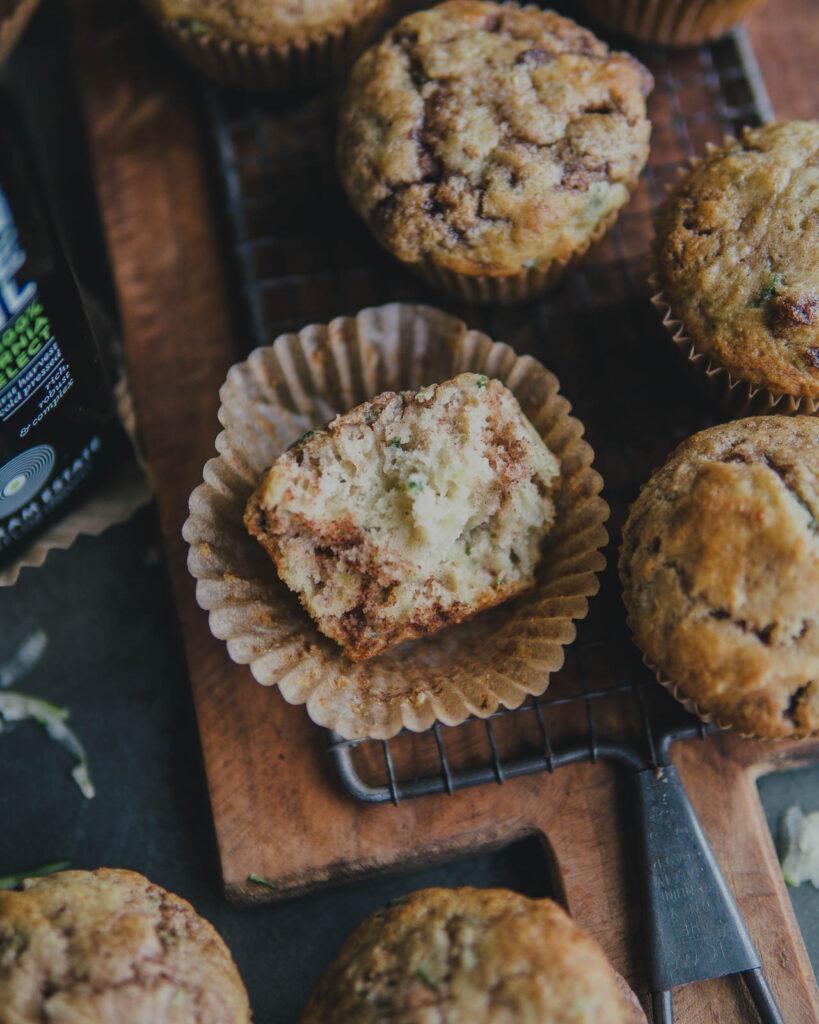 Cinnamon Sugar Zucchini Muffin cut in half showing swirl of cinnamon and sugar.