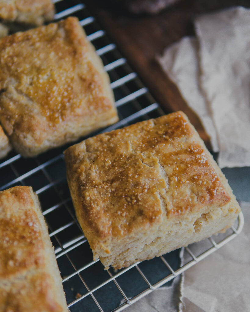 Buttermilk biscuits on a cooling rack.